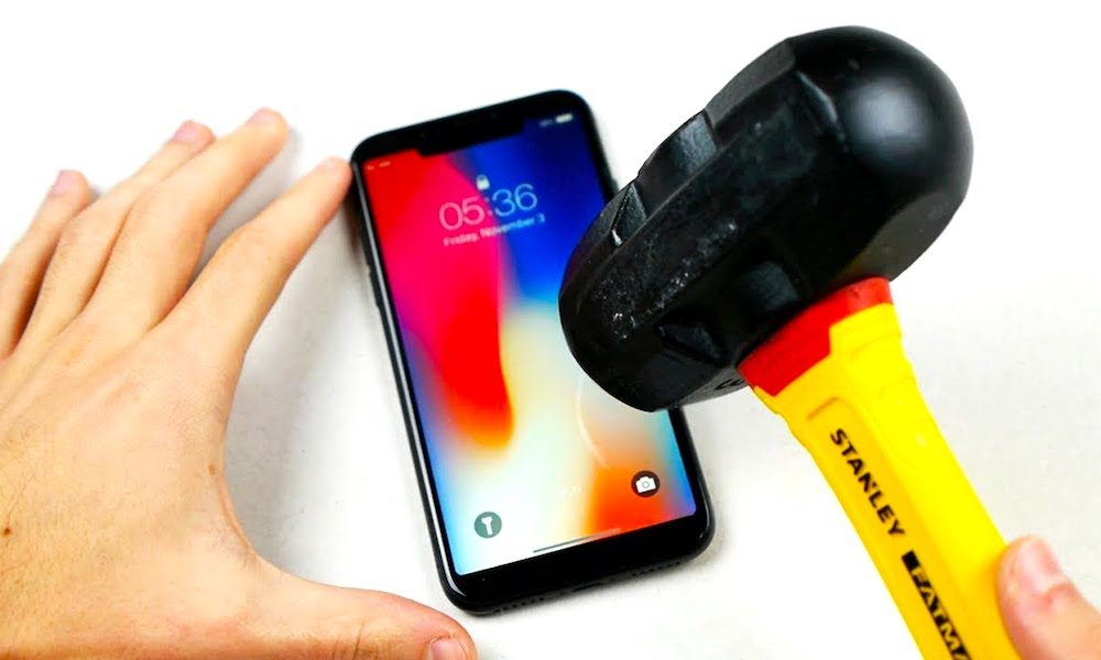 Watch an iPhone X Get Stabbed and Hit with a Hammer
