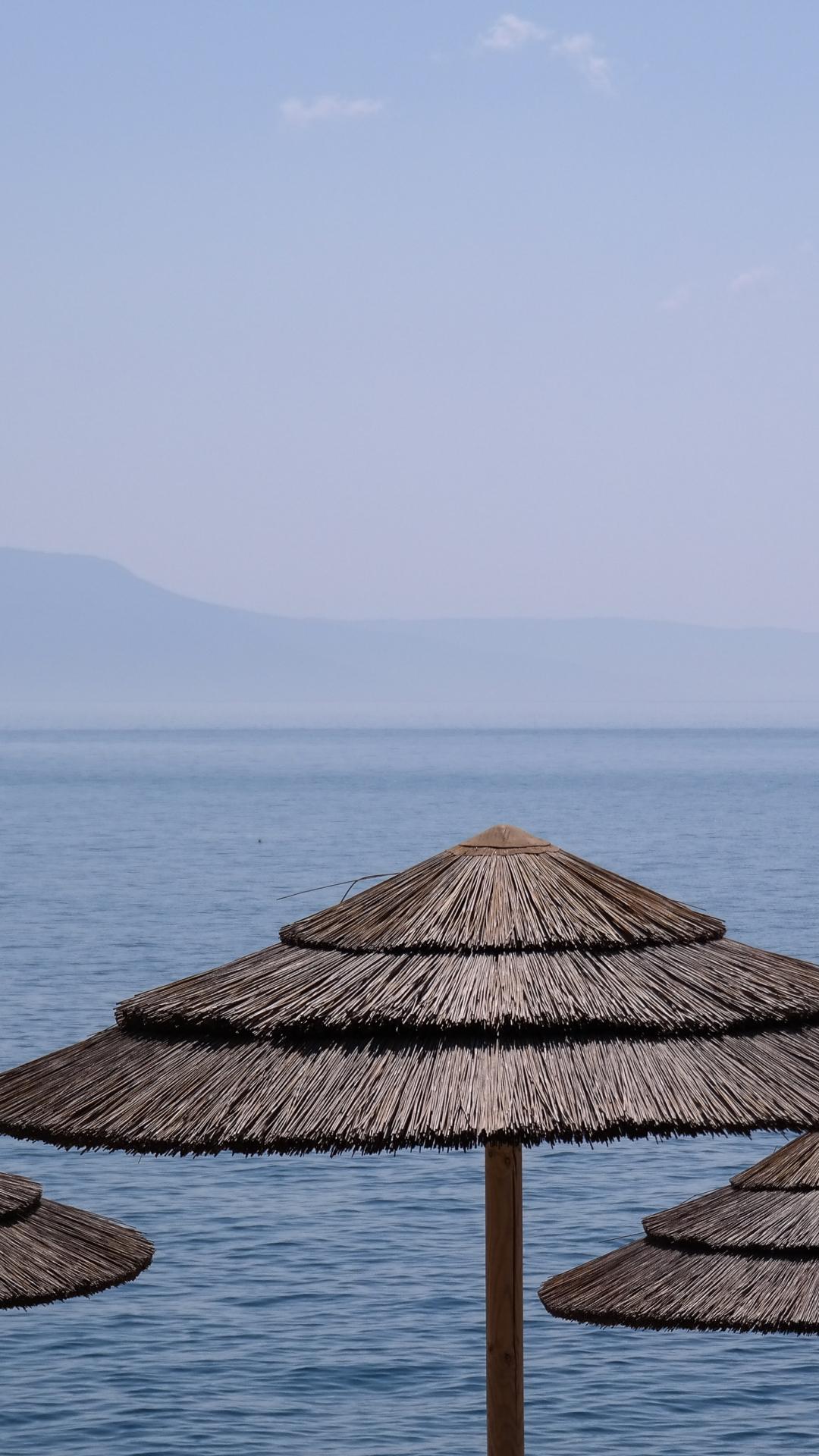Sea, Umbrella iPhone Wallpaper