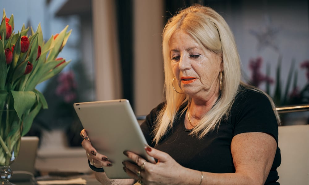 Older Woman Using Ipad Neck Pain Shoulder Hurts