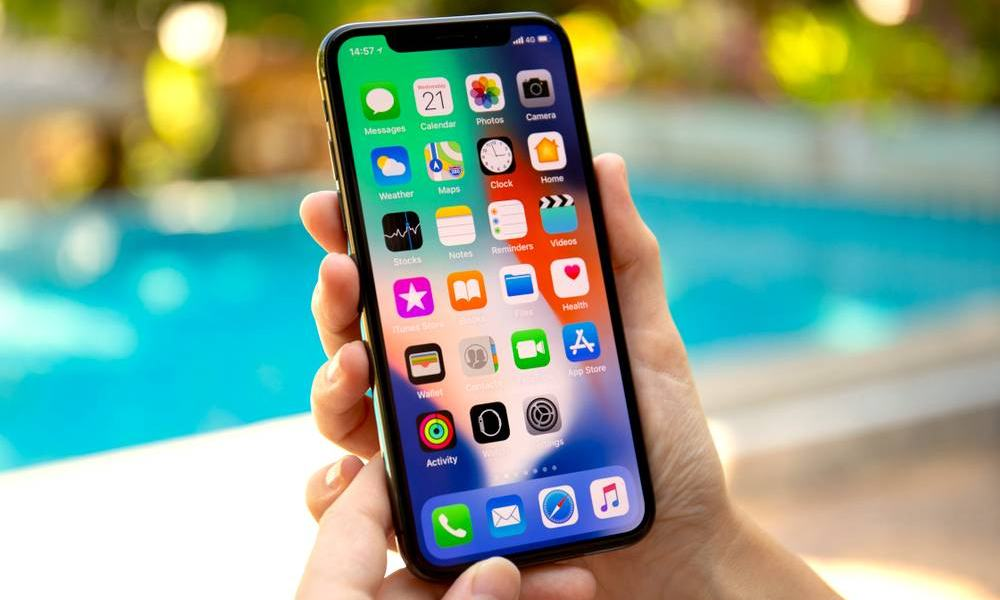 Holding Iphone X Ways To Lower Cell Phone Bill