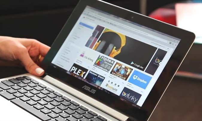 Holding Chromebook