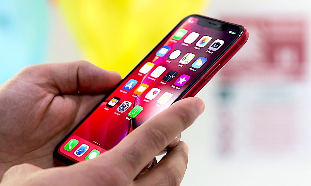 Holding Using Iphone Xr Red In Hands