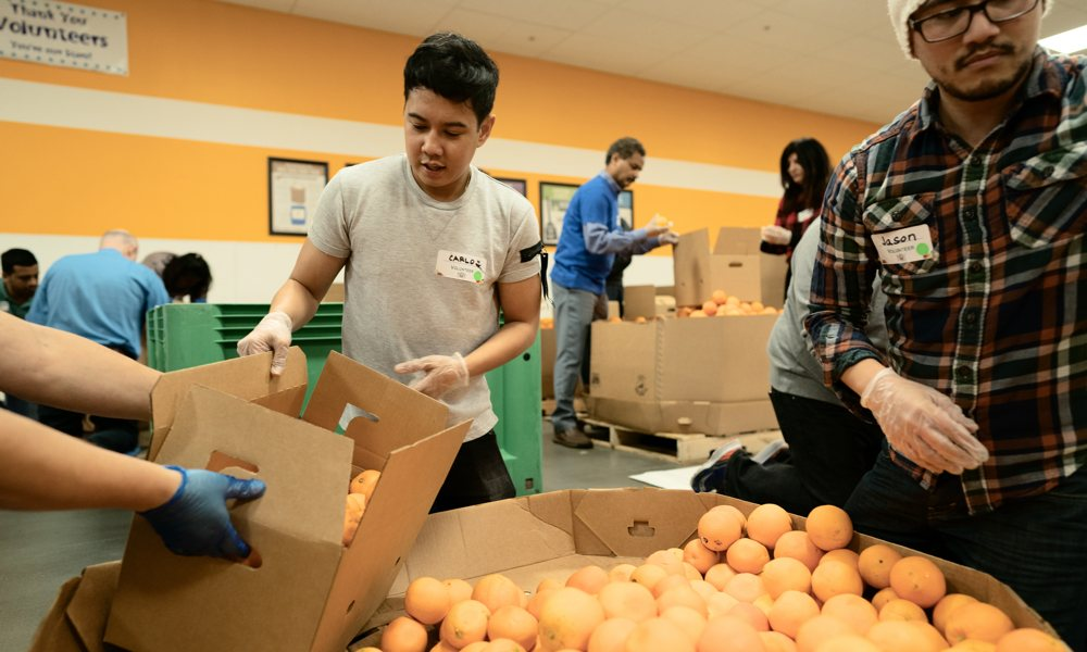 Apple Volunteers At Food Bank