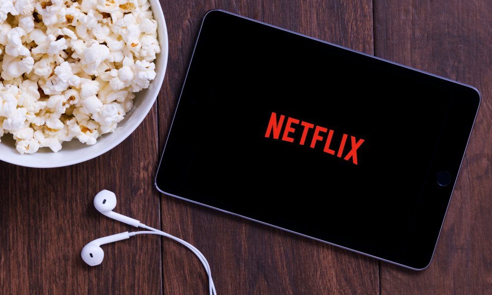 Netflix on iPad with Earpods and Popcorn