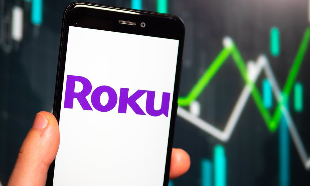 Hand Holding Phone With Roku Logo