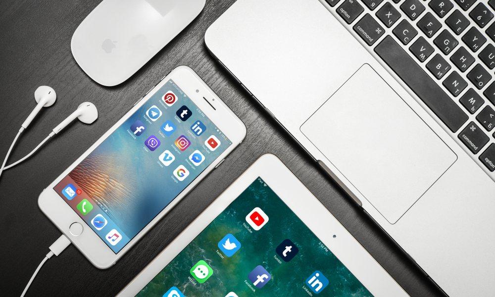 Iphone Ipad Macbook Earpods On Desk