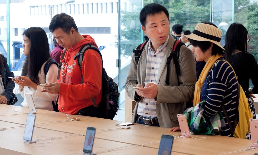 Chinese Customers Looking at iPhones In Apple Store