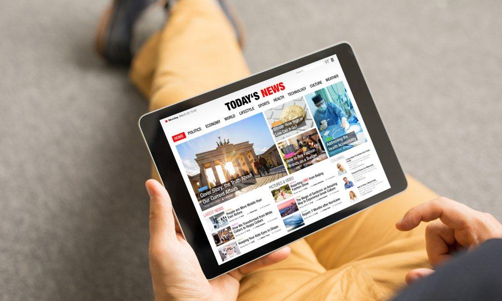 Man Reading Apple News on iPad