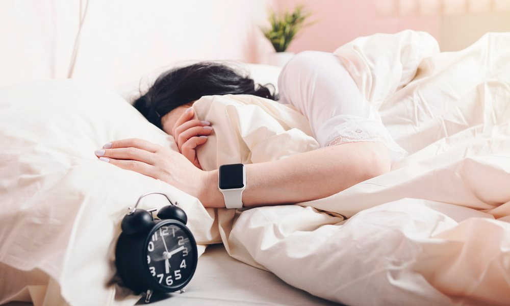 Woman Wearing Apple Watch In Bed
