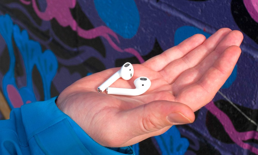 Holding Apple Airpods