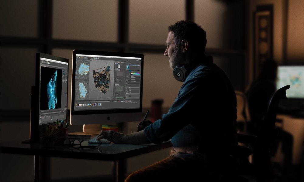 Man In Editing Studio Using iMacs