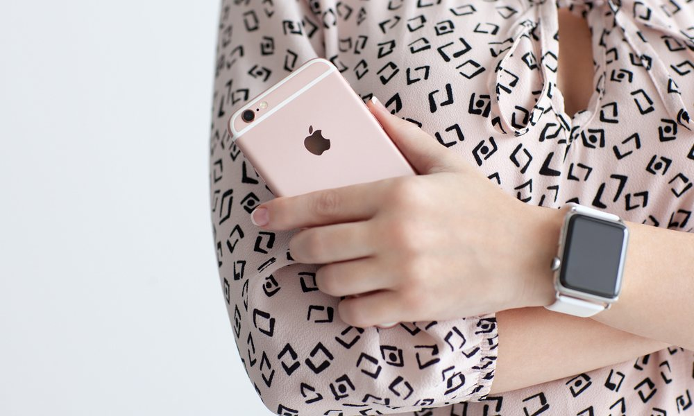 Woman Wearing Apple Watch Holding iPhone