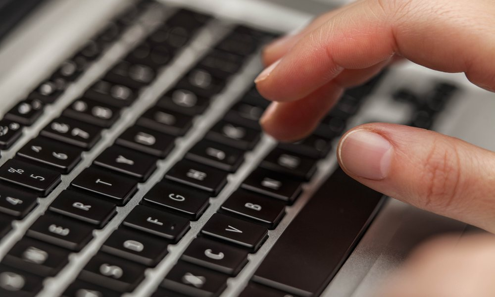 Hand Over MacBook Keyboard
