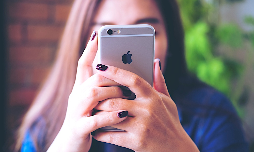 Woman Using Iphone 6 What Your Iphone Says About Your Personality