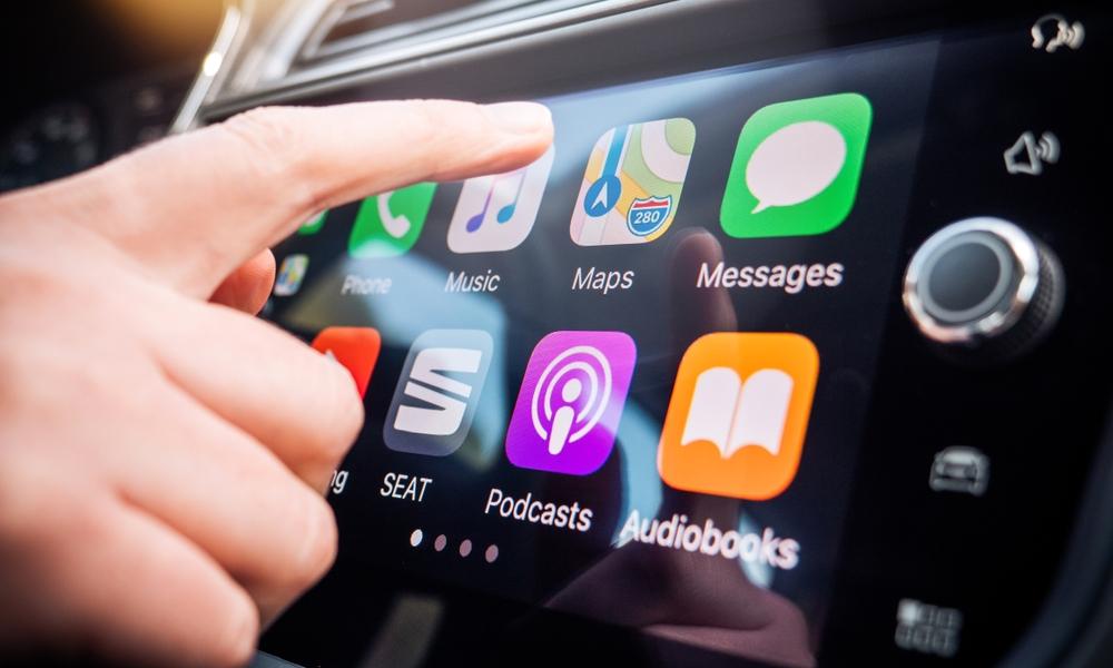 Hand Tapping CarPlay Screen