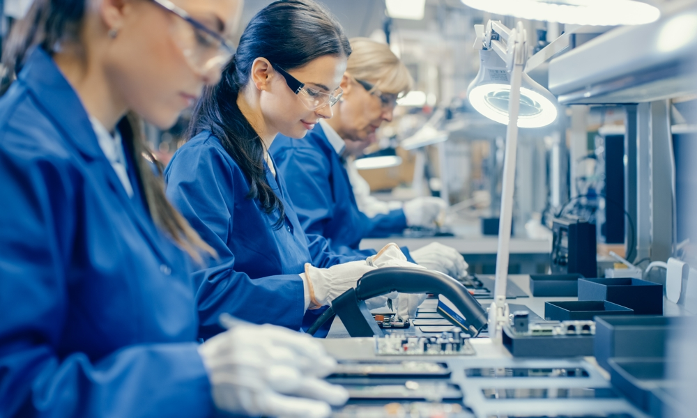 Factory Workers Assembling Electronics Production Manufacturing