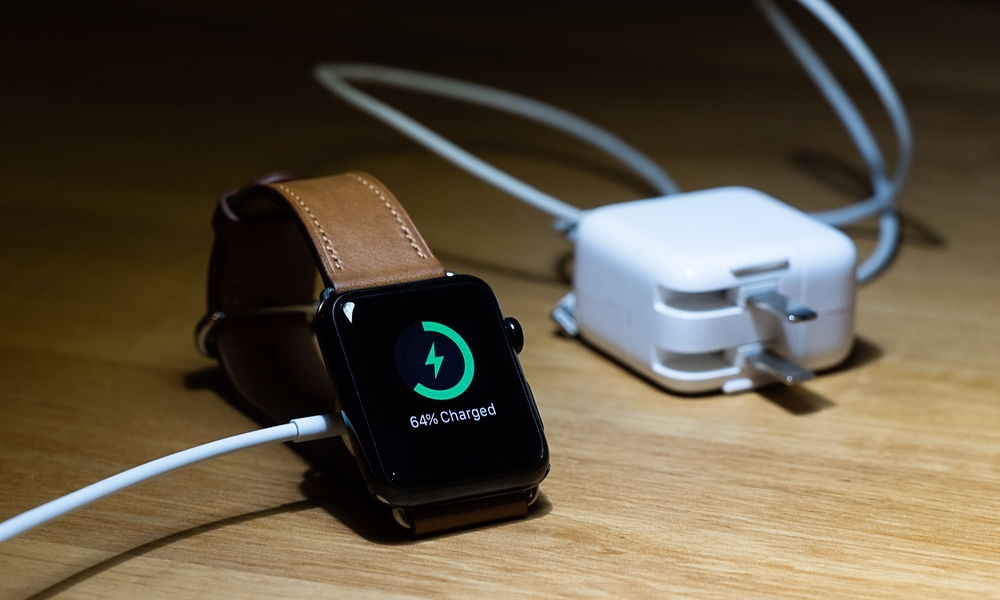 Apple Watch Charging Beside Power Adapter