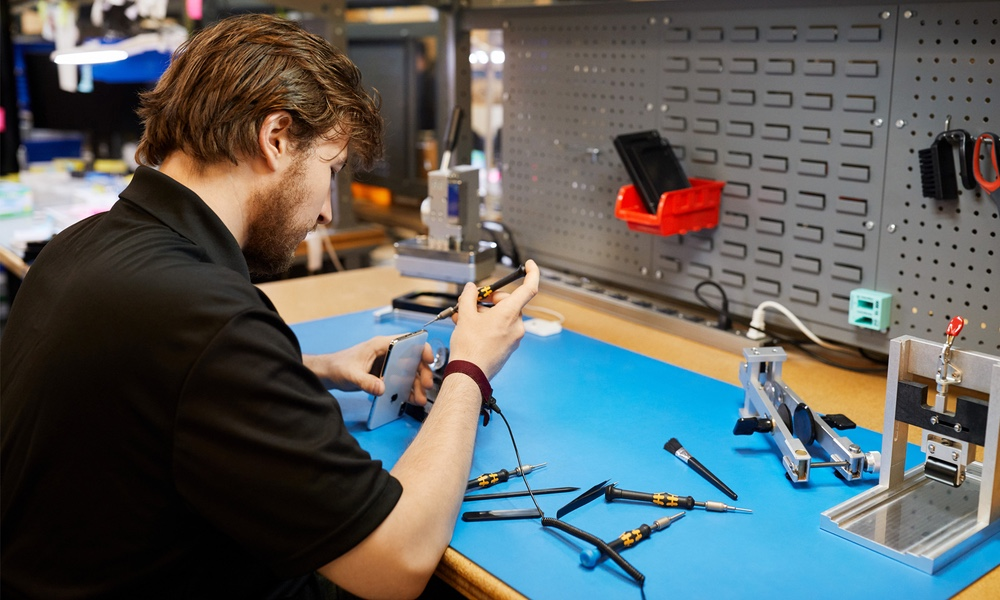 Technician Repairing iPhone