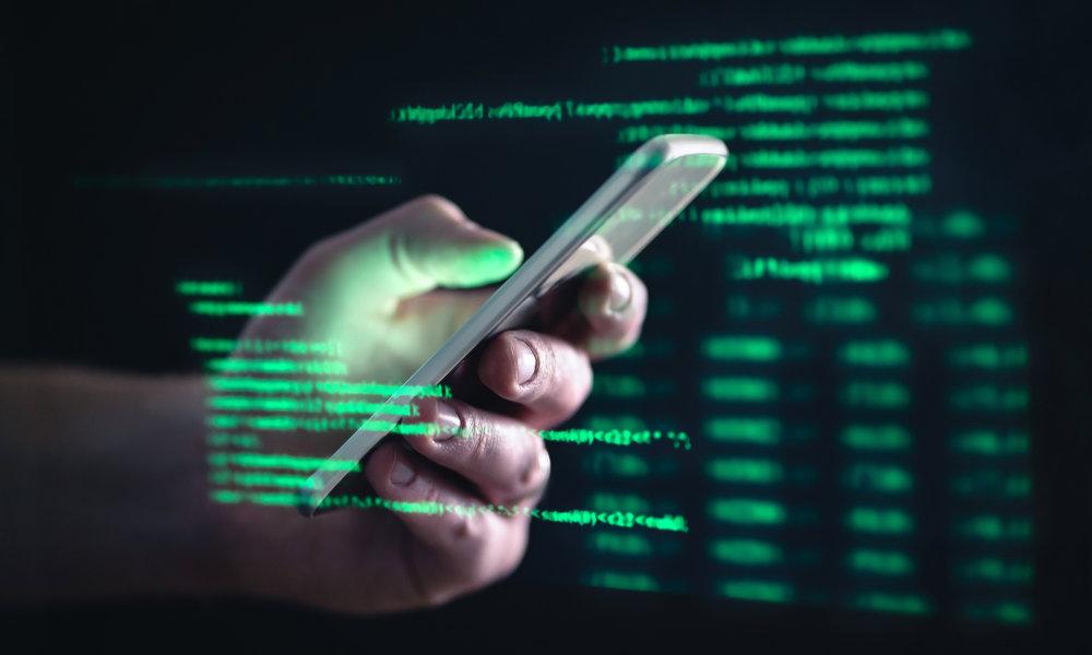 Darkweb Hacker Holding iPhone