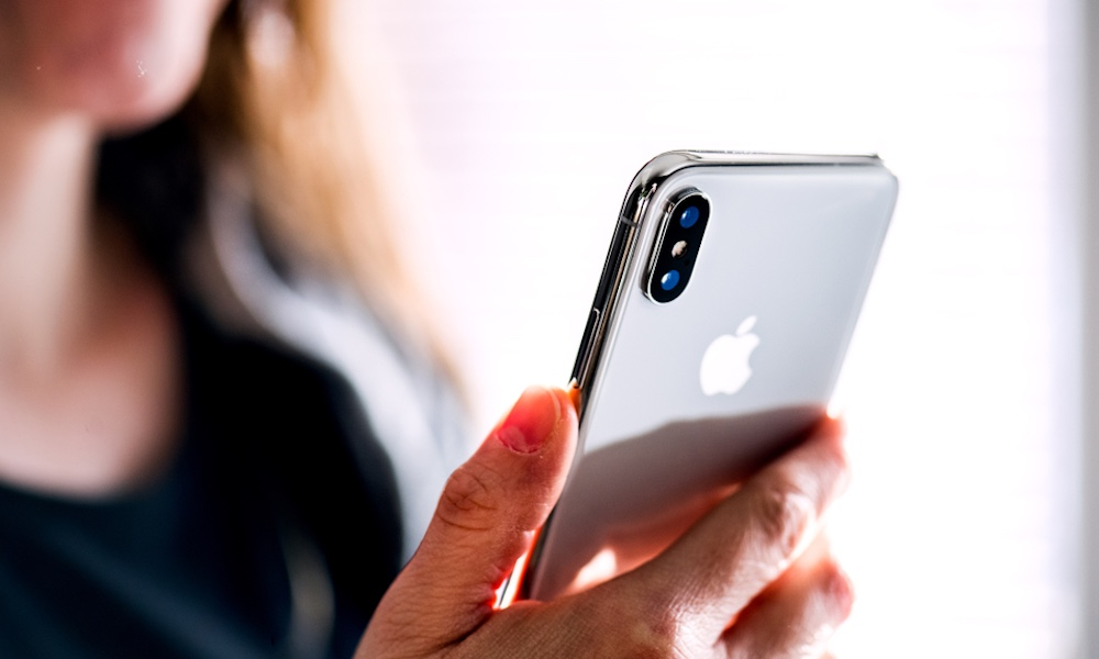 Woman Holding an iPhone XS