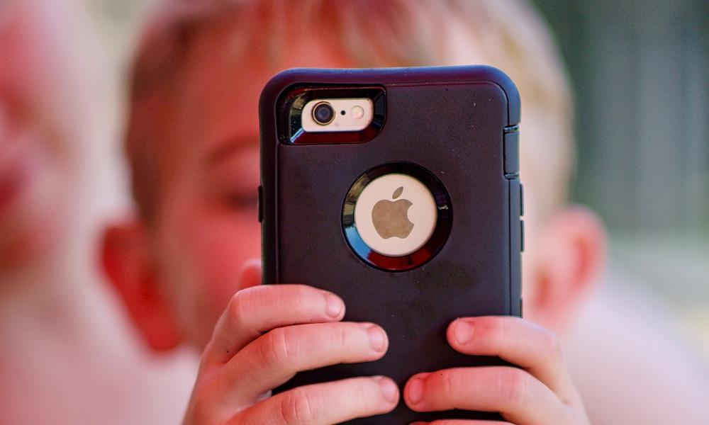 Communication Limits Kid Using iPhone