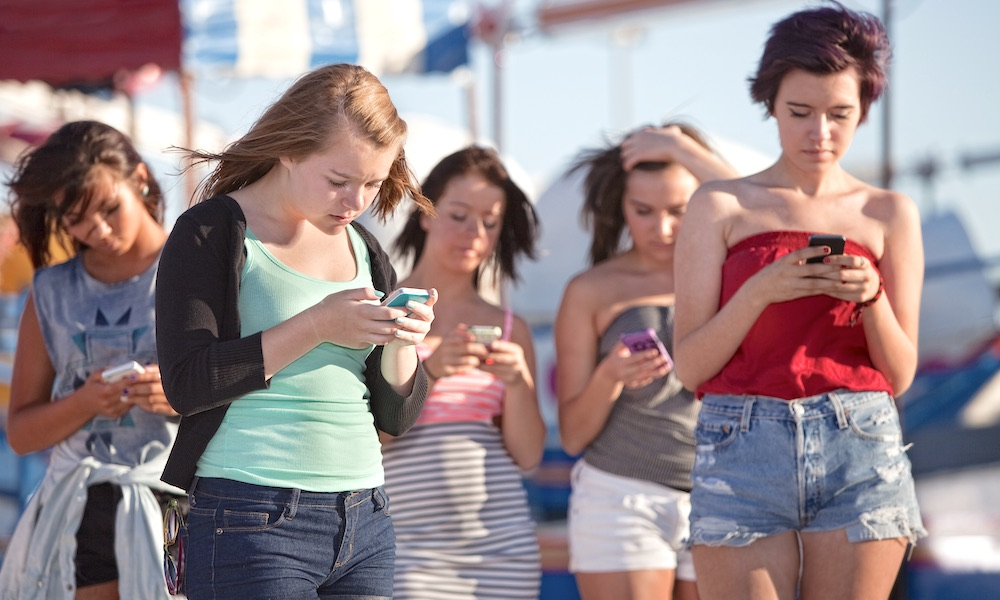 Young Adults and Teenagers Using Phones