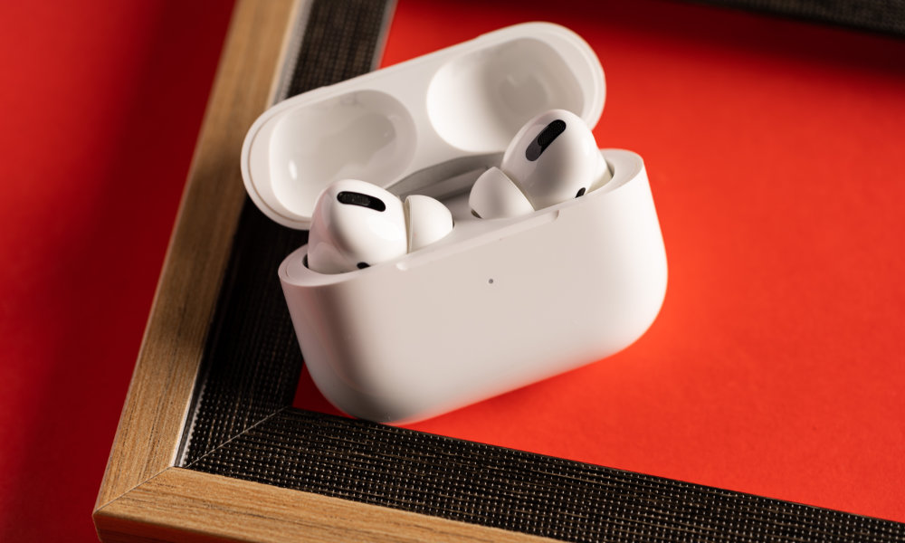 AirPods Pro on frame with red background