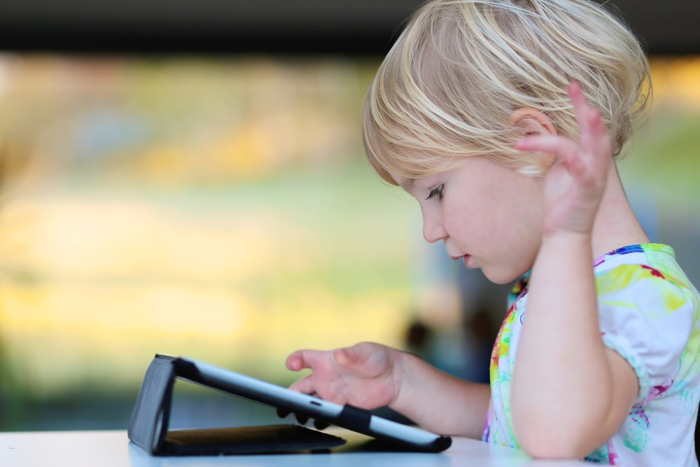 Younger Child Using an iPad