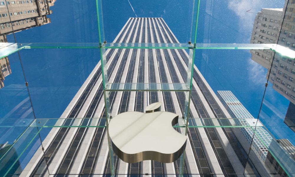 Apple logo against tall monolithic building