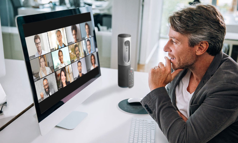 Zoom video call on iMac with multiple people