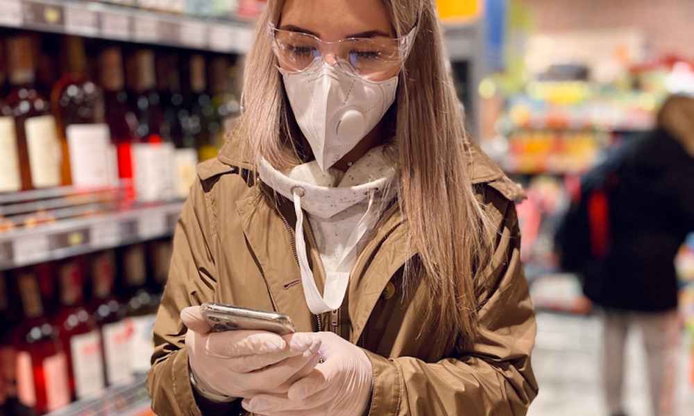 Woman Wearing Mask and Social Distancing Contact Tracing iPhone