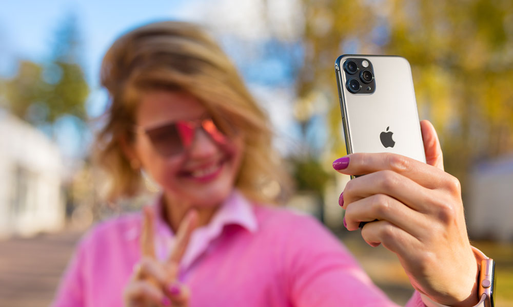 woman taking selfie with iPhone 11 Pro