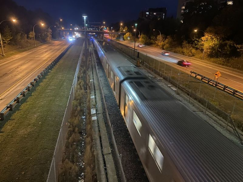 A train on a track at night