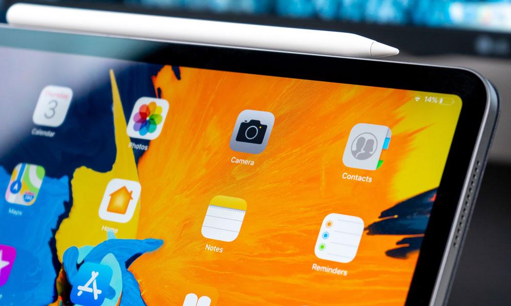 iPad Pro screen corner with Apple Pencil on top
