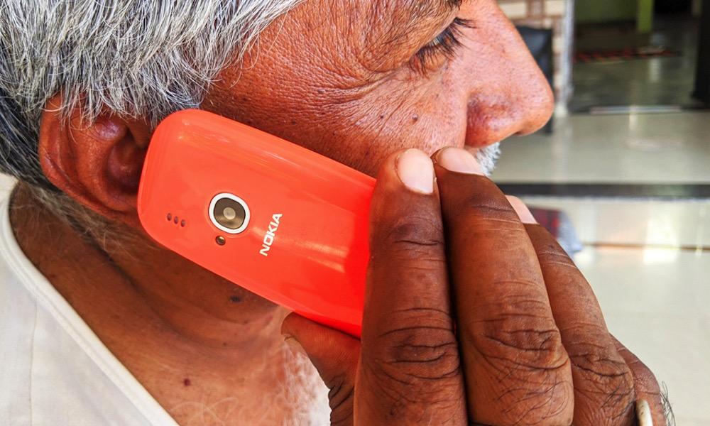 Older Adult Using Basic Nokia 3G Phone
